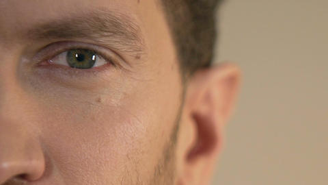 Close-up of serious man's face looking into camera, emotion, body language Footage