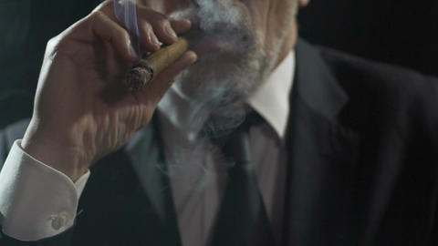 Overbearing oligarch enjoying cigar smoking, authority and power, slowmotion Footage