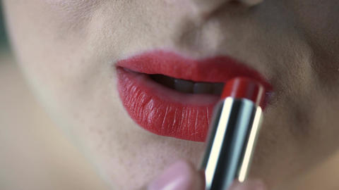 Obese female applying red lipstick and preparing for date with boyfriend Footage