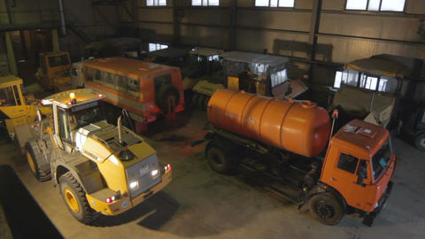 Upper View Garage and Orange Lorry with Cistern Driving out Footage