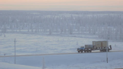 Beautiful Landscape with Large Lorry Drives on Empty Road Footage