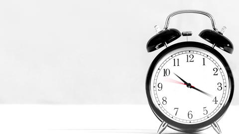 Table clock with fast forward time white background ビデオ
