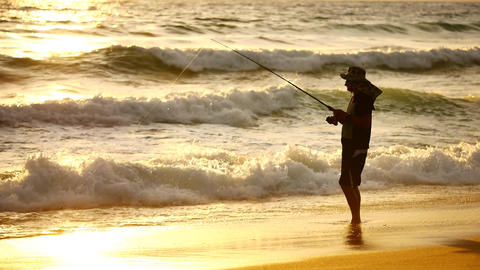 The silhouette fisherman are fishing on the beach. Monsoon season Fishing is a Archivo