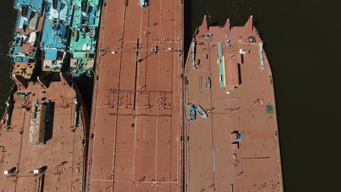 Boats and barges moored in river Footage
