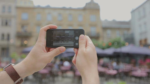 Young tourist man taking video of the city with his smartphone Footage