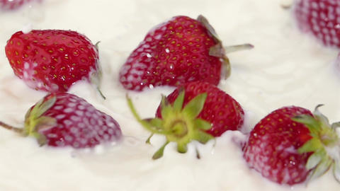 Ripe Strawberries Falling into the Milk Footage