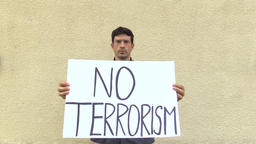 Demonstration against terrorism and terror, banner no terrorism, czech activist Filmmaterial