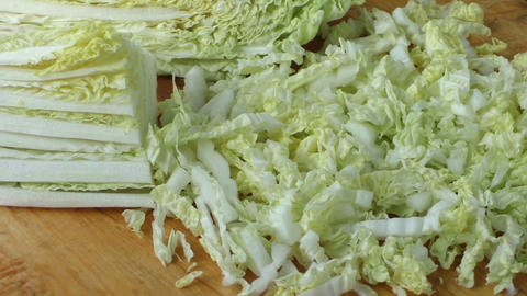 Fresh green organic healthy sliced and chopped chinese cabbage Footage