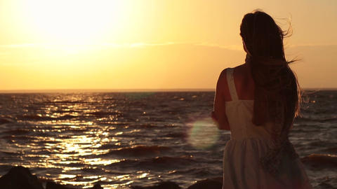 Happy woman relaxation on sea beach at sunset Footage