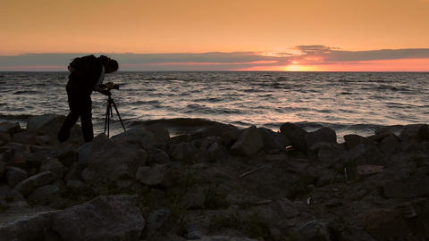 Skillful photograper shooting sea in twilight time Footage