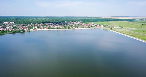 Aerial Drone View Of Small Country Town With Lake On Blue Sky In Summer Filmmaterial