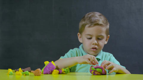 Little boy play with plasticine Image