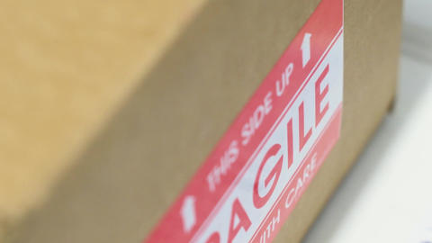 Cardboard box with fragile sticker Footage