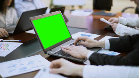 Businessman working on laptop with green screen at business meeting, conference Footage
