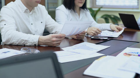 Colleagues passing document to boss, employee looking at fluctuation graph Footage