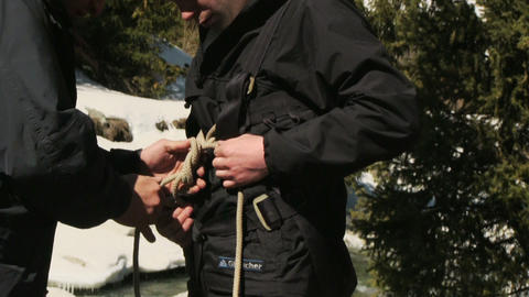 Climber checks equipment Live Action