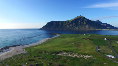 Flying over picturesque village Flakstad on Lofoten Footage