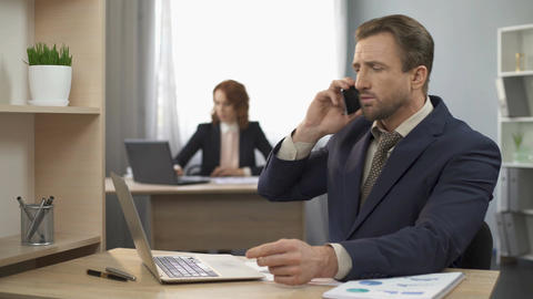 Businessman talking over mobile phone with client, appointing meeting, deal Footage