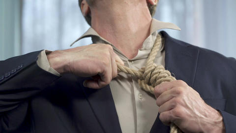Guy trying to take off death rope from his neck, binding commitment, powerless Live Action