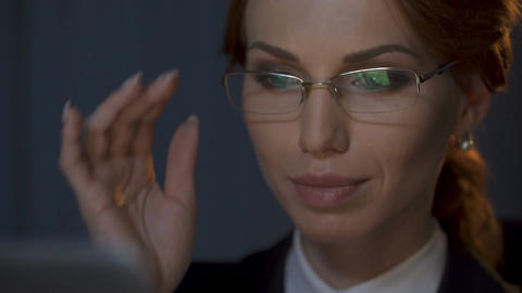 Businesswoman taking off her glasses and looking carefully at laptop screen Footage
