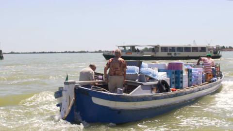 Little old trade motorboat supplying necessary household goods between islands Footage