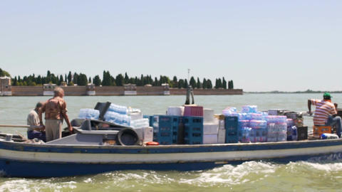 Small commercial boat crew transporting products from large merchant vessel Footage