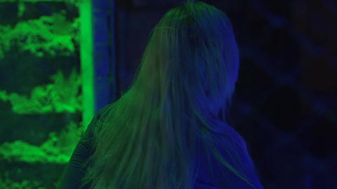 Blonde girl enjoying dance in the night club, relaxing atmosphere, slow-motion Footage