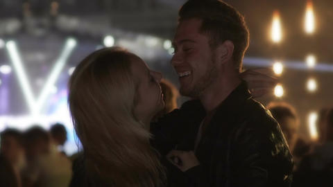 Beautiful young couple laughing, dancing and enjoying amazing evening at club Footage