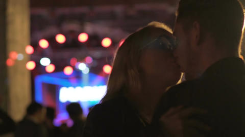 Man and woman kissing ardently and dancing at DJ music festival, relationship Footage