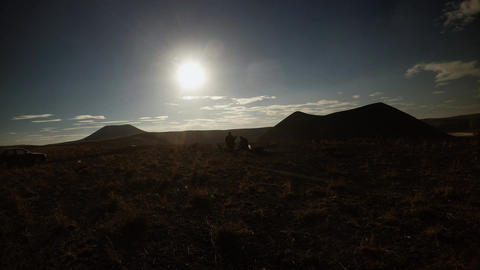 Shepherds in The Rays of Sunset in The Distance, near a smoking fire and an old  Footage
