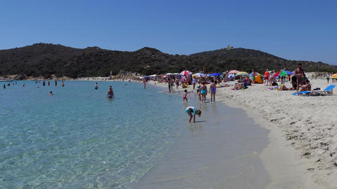 White Sand Beach And Tourists People Swimming In Sardinia Italy Footage