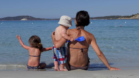 Happy Family Playing On The Beach Near The Sea Footage