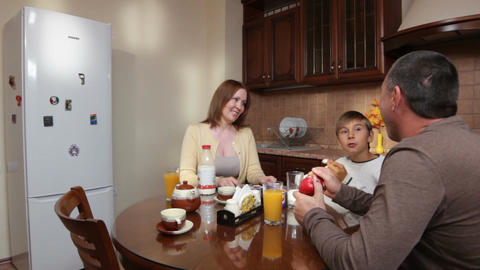 Happy Family Sit at Kitchen against Pozis Fridge Footage