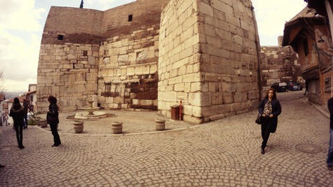 Street around ancient Defensive wall of citadel Hisar Fountain tourists Ankara Live Action