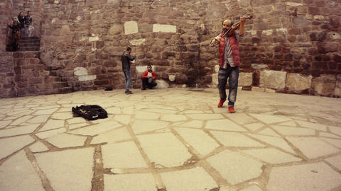 Turkish gypsies play music ask money live sound in courtyard of citadel Hisar to Live Action