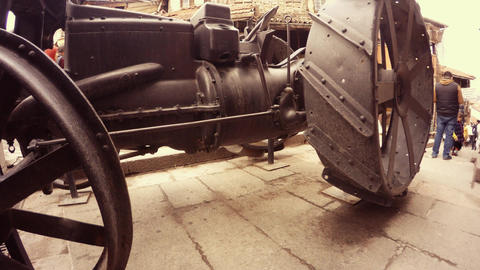 Ancient tractor wheels in front of camera passersby Ankara Footage