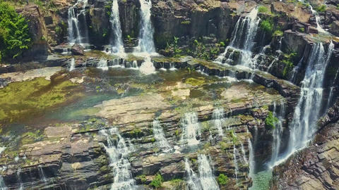 Drone Hangs Close to Waterfalls Pongour Flowing from Cliffs Footage