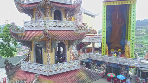 Drone Flies Close to Pagoda Bell Tower from Bottom to Roof Footage