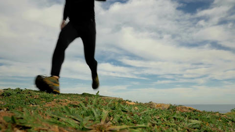 HD shot of young sport man running towards the camera in off road trail countrys Filmmaterial