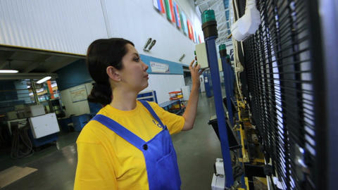 Woman Worker Comes to Machine and Presses Buttons Footage
