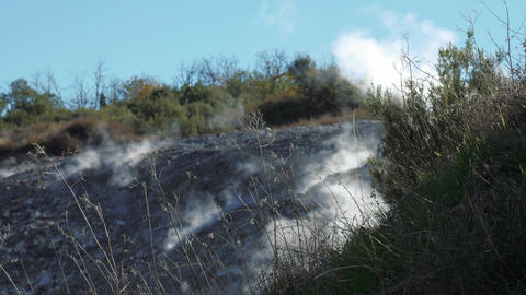 Steam from geothermal source comes out from the ground Footage