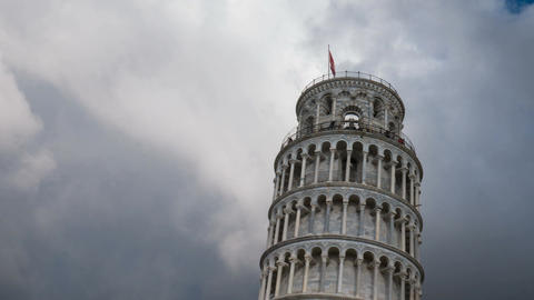 Dramatic timelapse of clouds casting dynamic lights on Pisa leaning tower Footage