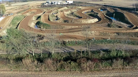 Slow motion aerial dolly of amateur motocross race, slow motion Live Action
