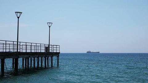 A pier and a distant ship Footage