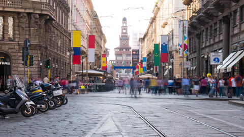 Milan, Italy: Via Dante Street with flags and Castle in the background timelapse Footage