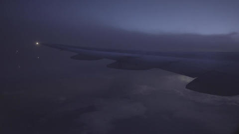 View of clouds and lightning from aircraft window Footage