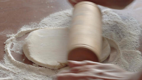 Woman is kneading the dough Footage
