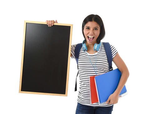 hispanic woman or female student holding blank blackboard with copy space for ad Fotografía
