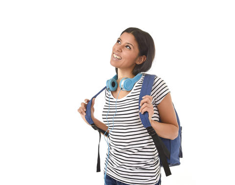 beautiful and trendy latin student girl carrying backpack smiling happy thinking フォト