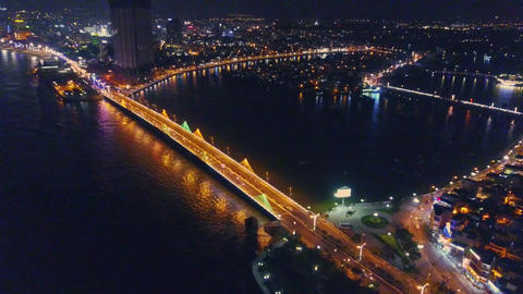 Flycam Opens View of Night City with Bridge across Bay Footage